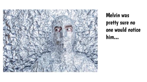 man under blanket of aluminum foil