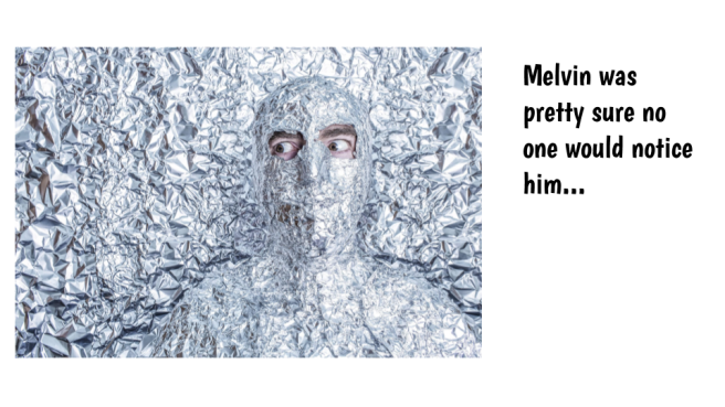 man under blanket of aluminum foil