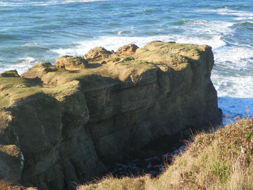 rocky bluff jutting out into ocean
