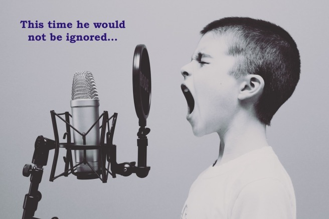 boy yelling into microphone captioned