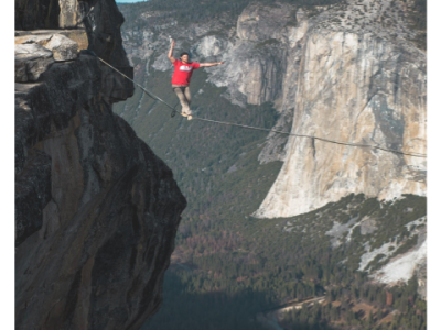 man on tightrope over canyon