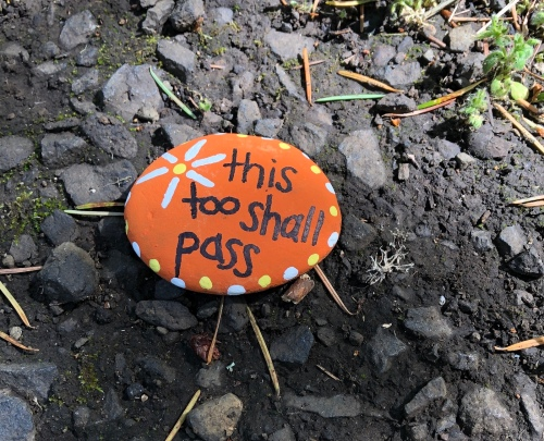rock with this too shall pass painted on it